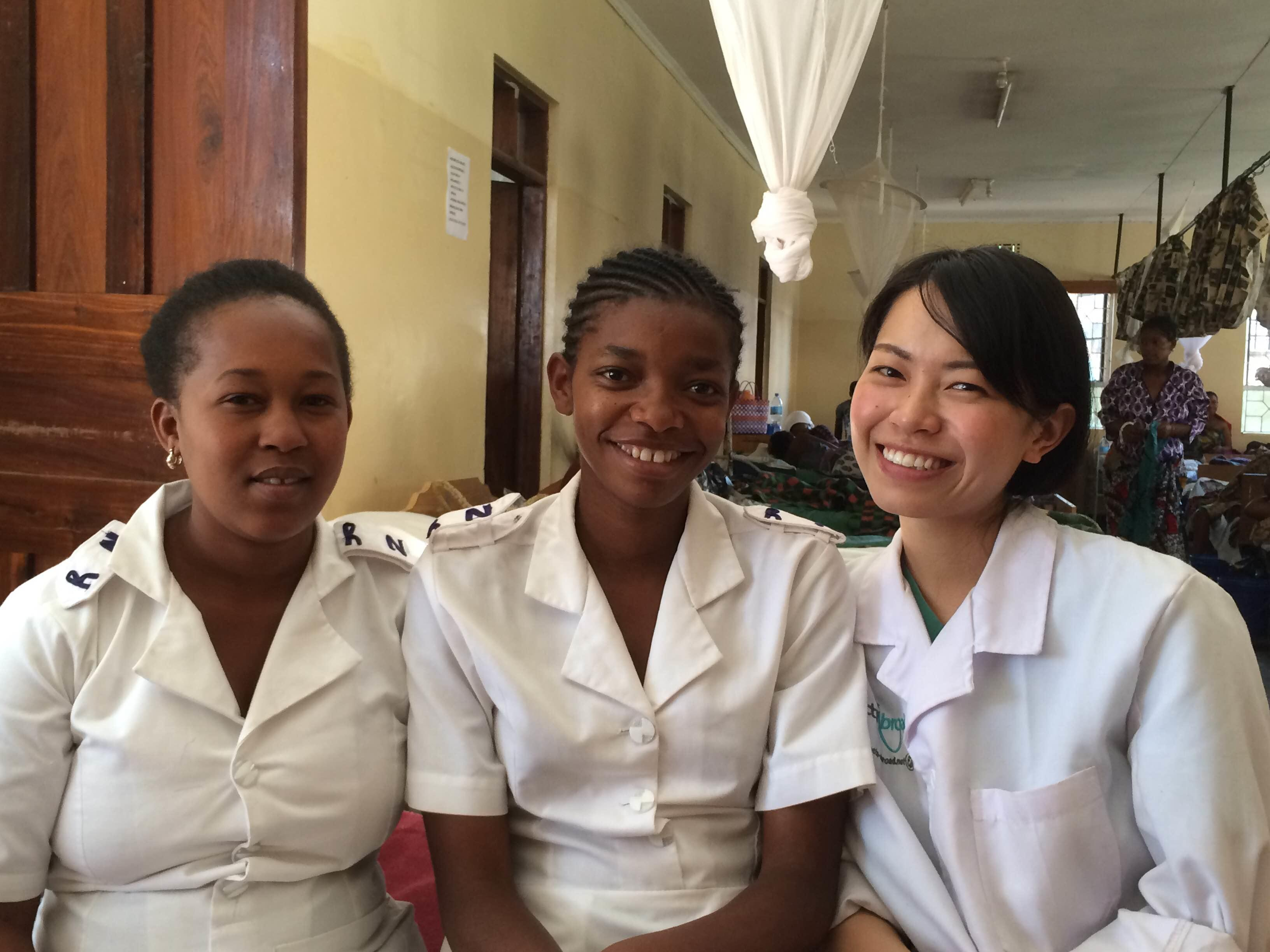 A student doing a Nursing internship abroad in Tanzania enjoys spending time with her local colleagues.